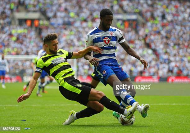 Tommy Smith of Huddersfield Town tackles Tyler Blackett of Reading during the Sky Bet Championship play off final between Huddersfield and Reading at...