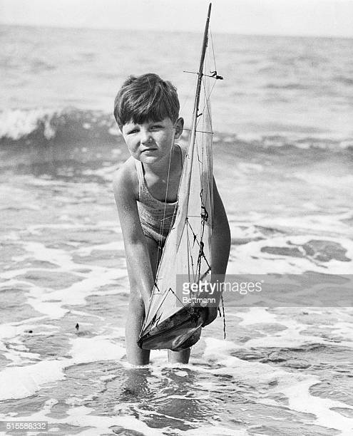 Tommy Sopwith son of prominent English aeronaut and America's Cup competitor plays with a toy sailboat along the shores of Westgate on Sea England