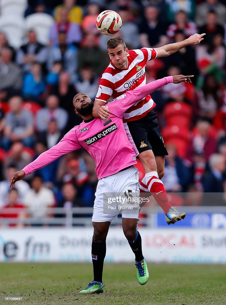 Tommy Spurr (R) of Doncaster in action with Yoann Arquin of Notts County during the npower League One match between Doncaster Rovers and Notts County at the Keepmoat Stadium on April 20, 2013 in Doncaster, England.