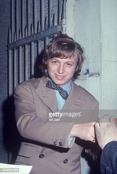Tommy Steele after his performance in Half a Sixpence on Broadway signing autographs circa 1970 New York