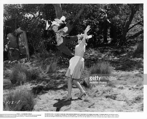 Tommy Steele and Petula Clark in dance sequence in a scene from the film 'Finian's Rainbow' 1968
