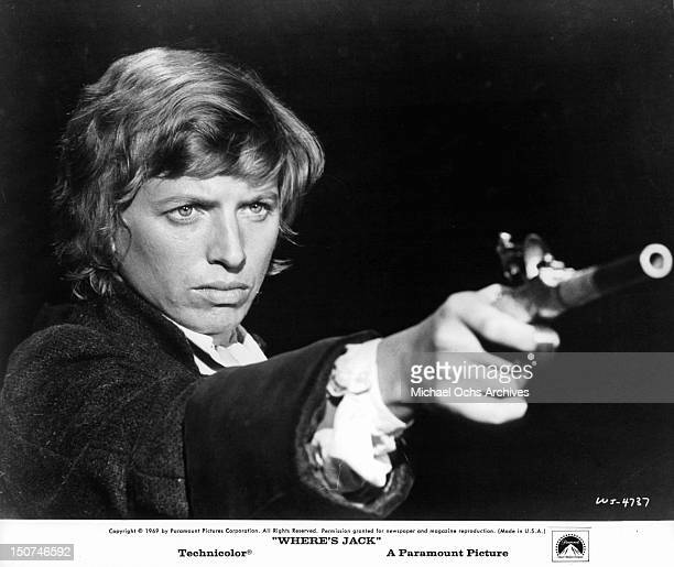 Tommy Steele pointing a gun in a scene from the film 'Where's Jack' 1969
