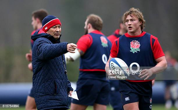 Tommy Taylor looks on as Eddie Jones the England head coach issues instructions during the England training session held at Pennyhill Park on March...