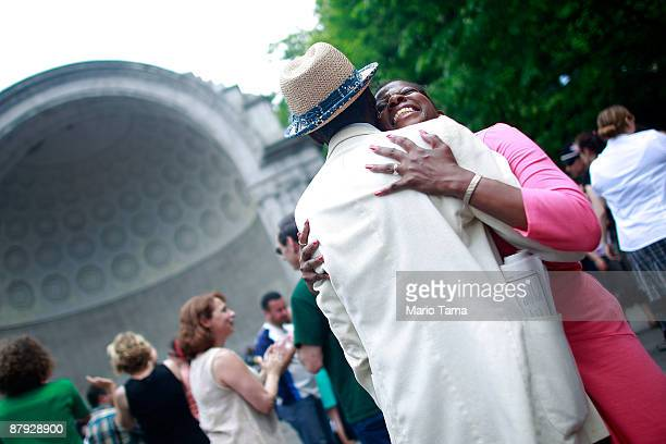 Tommy Tucker and Sarina Robinson swing dance in Central Park to honor legendary Lindy Hop dancer Frankie Manning May 22 2009 in New York City Lindy...