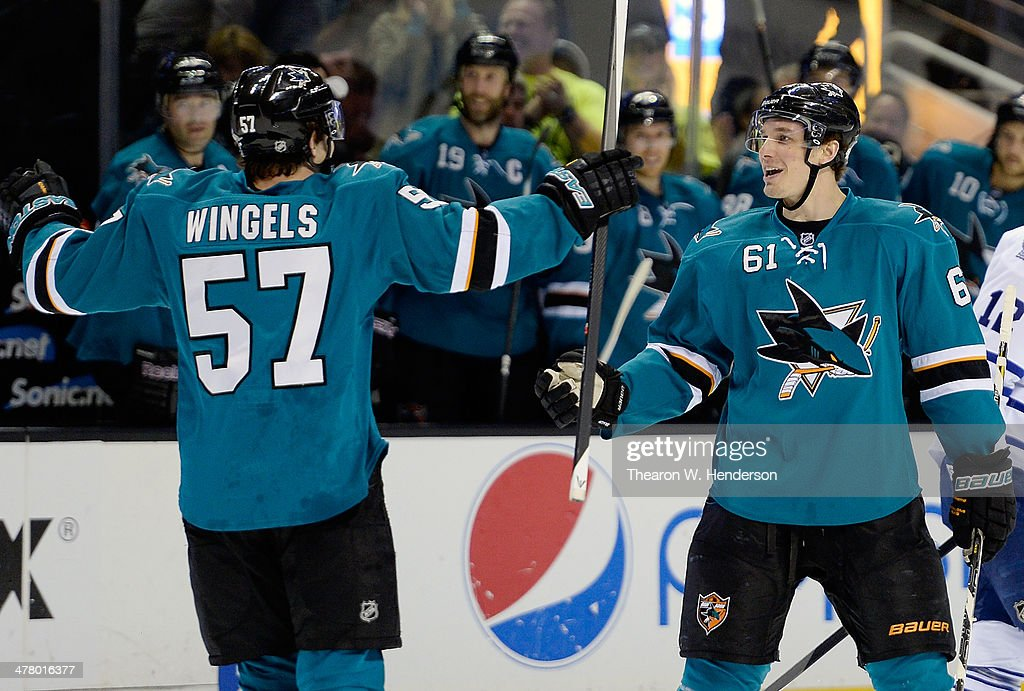 <a gi-track='captionPersonalityLinkClicked' href=/galleries/search?phrase=Tommy+Wingels&family=editorial&specificpeople=5807738 ng-click='$event.stopPropagation()'>Tommy Wingels</a> #57 and Justin Braun #61 of the San Jose Sharks celebrate after Wingels scored a goal against the Toronto Maple Leafs during the second period at SAP Center on March 11, 2014 in San Jose, California. Braun had an assist on the goal.