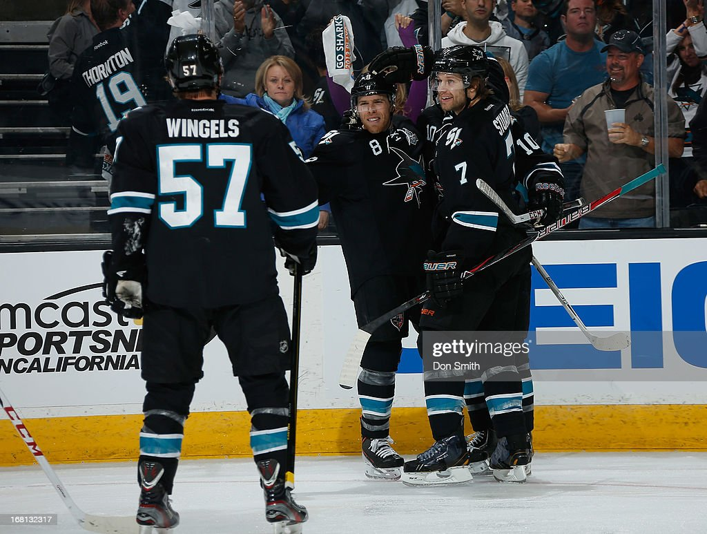 Tommy Wingels #57, Joe Pavelski #8 and Brad Stuart #7 of the San Jose Sharks celebrate Pavelski's goal against the Vancouver Canucks in Game One of the Western Conference Quarterfinals during the 2013 Stanley Cup Playoffs at HP Pavilion on May 5, 2013 in San Jose, California.