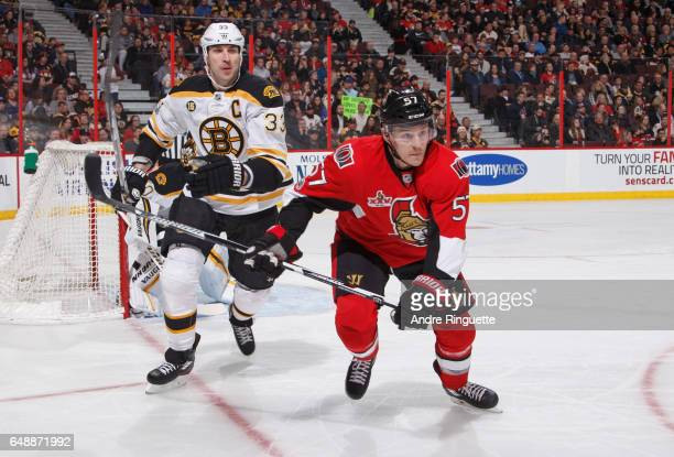 Tommy Wingels of the Ottawa Senators battles for position against Zdeno Chara of the Boston Bruins at Canadian Tire Centre on March 6 2017 in Ottawa...