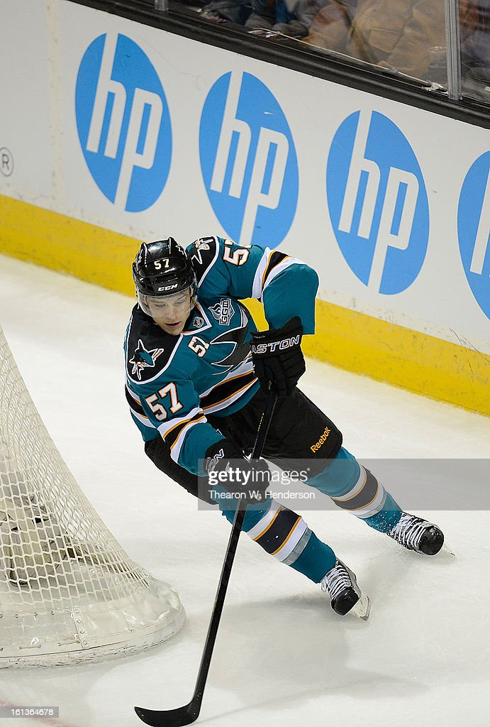 Tommy Wingels #57 of the San Jose Sharks attacks the goal from behind the net against the Phoenix Coyotes in the third period at HP Pavilion on February 9, 2013 in San Jose, California. The Coyotes won the game 1-0 in an overtime shoot-out.