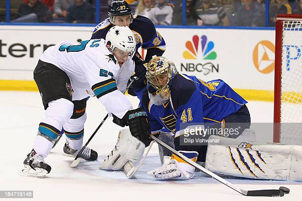 Tommy Wingels of the San Jose Sharks attempts to score a goal against Jaroslav Halak of the St Louis Blues at the Scottrade Center on October 15 2013...