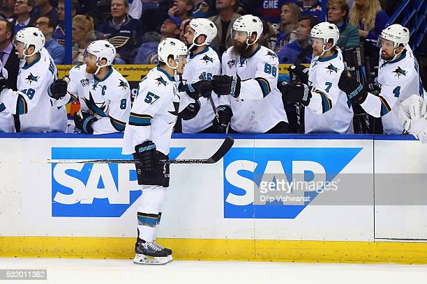 Tommy Wingels of the San Jose Sharks celebrates with teammates after scoring a first period goal against Brian Elliott of the St Louis Blues in Game...