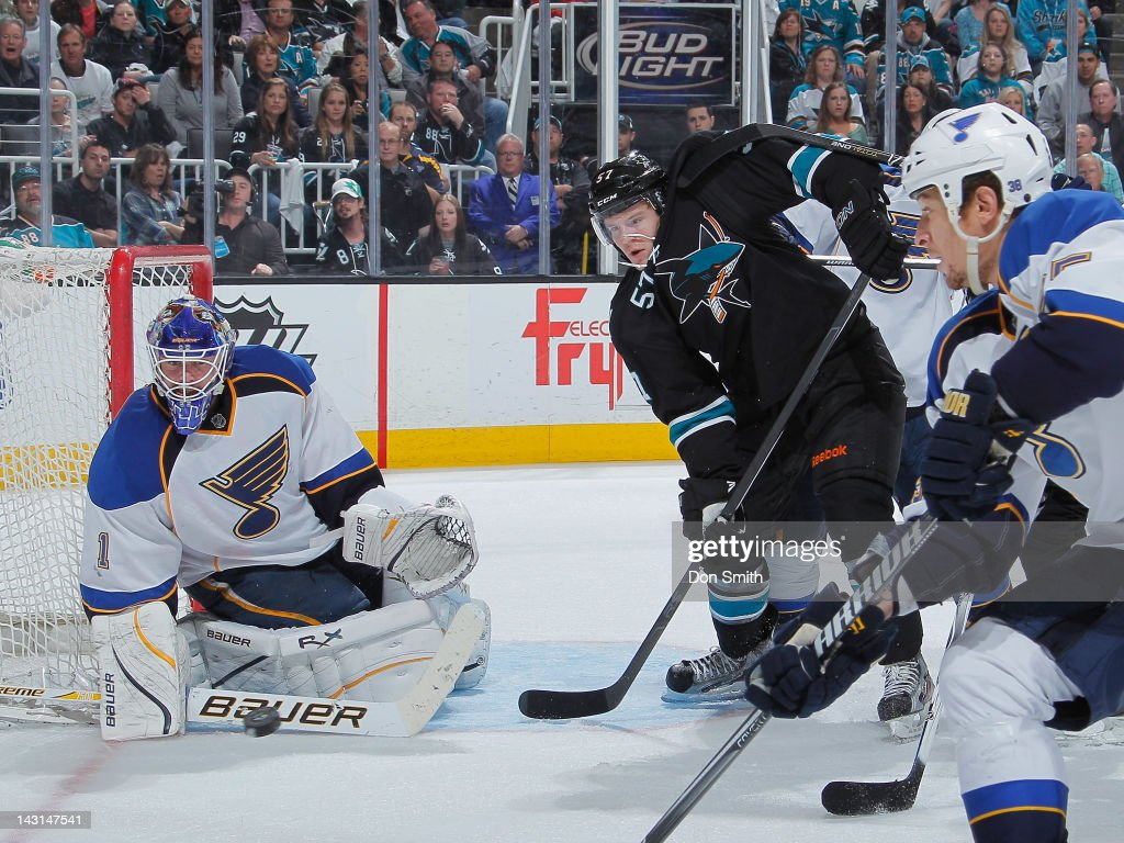 Tommy Wingels #57 of the San Jose Sharks crowds the front of the net against Billy Elliott #1 of the St. Louis Blues in Game Four of the Western Conference Quarterfinals during the 2012 NHL Stanley Cup Playoffs at HP Pavilion on April 19, 2012 in San Jose, California.
