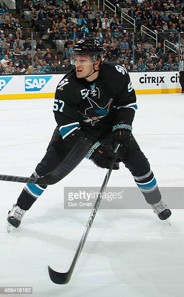 Tommy Wingels of the San Jose Sharks forechecks against the Vancouver Canucks during an NHL game on November 6 2014 at SAP Center in San Jose...