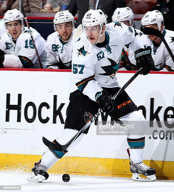 Tommy Wingels of the San Jose Sharks handles the puck against the Anaheim Ducks on December 22 2014 at Honda Center in Anaheim California