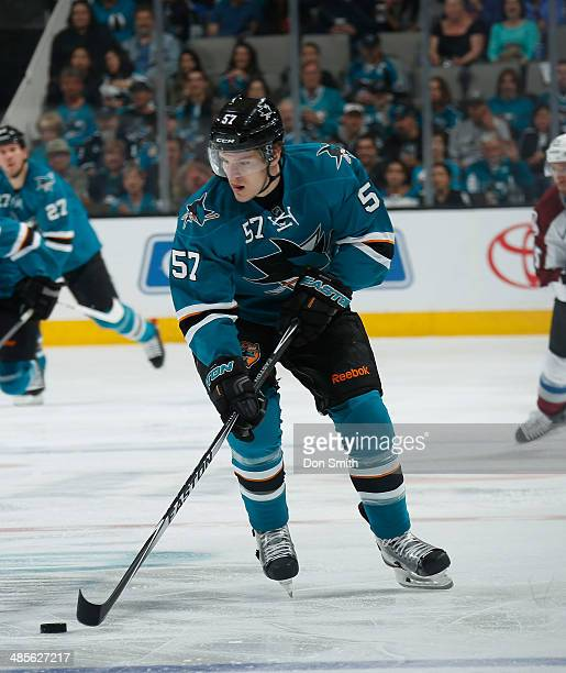 Tommy Wingels of the San Jose Sharks handles the puck against the Colorado Avalanche during an NHL game on April 11 2014 at SAP Center in San Jose...