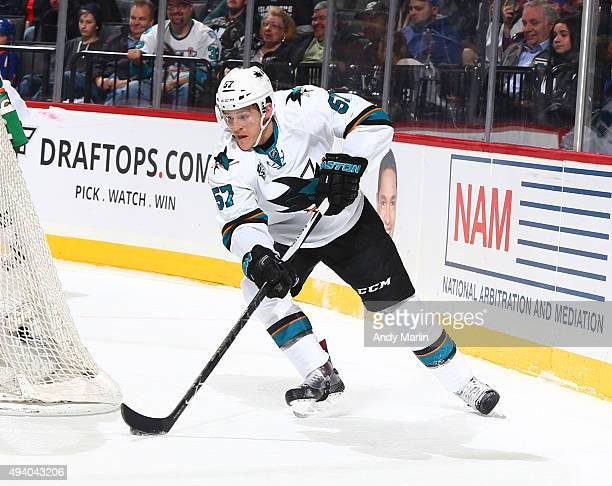 Tommy Wingels of the San Jose Sharks plays the puck against the New York Islanders at the Barclays Center on October 17 2015 in the Brooklyn borough...
