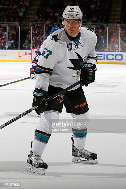Tommy Wingels of the San Jose Sharks skates against the New York Islanders at Nassau Veterans Memorial Coliseum on October 16 2014 in Uniondale New...
