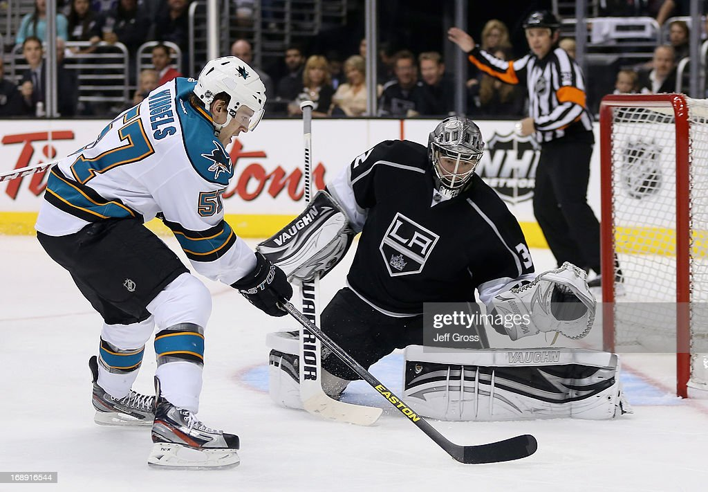 <a gi-track='captionPersonalityLinkClicked' href=/galleries/search?phrase=Tommy+Wingels&family=editorial&specificpeople=5807738 ng-click='$event.stopPropagation()'>Tommy Wingels</a> #57 of the San Jose Sharks skates in on goaltender <a gi-track='captionPersonalityLinkClicked' href=/galleries/search?phrase=Jonathan+Quick&family=editorial&specificpeople=2271852 ng-click='$event.stopPropagation()'>Jonathan Quick</a> #32 of the Los Angeles Kings in the third period of Game Two of the Western Conference Semifinals during the 2013 NHL Stanley Cup Playoffs at Staples Center on May 16, 2013 in Los Angeles, California. The Kings defeated the Sharks 4-3.