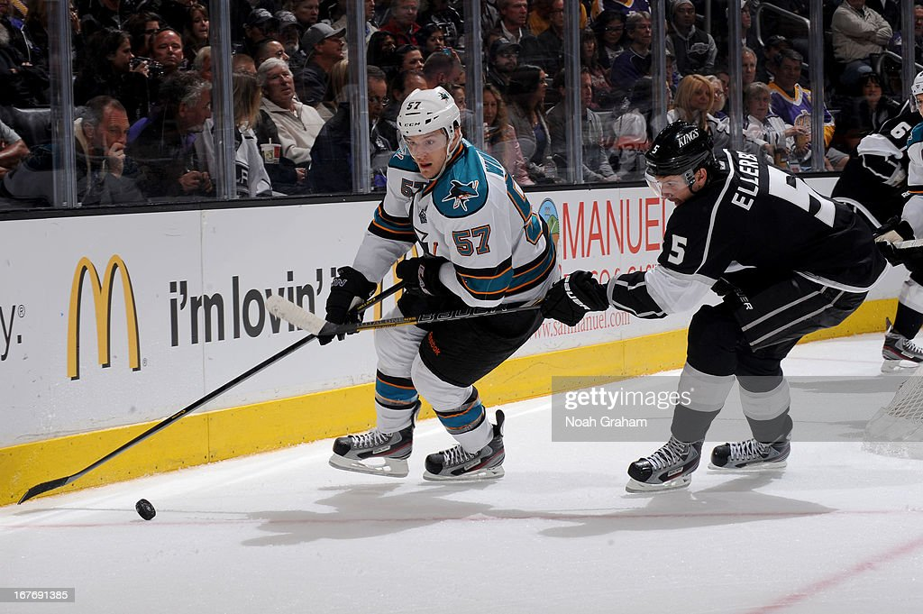 <a gi-track='captionPersonalityLinkClicked' href=/galleries/search?phrase=Tommy+Wingels&family=editorial&specificpeople=5807738 ng-click='$event.stopPropagation()'>Tommy Wingels</a> #57 of the San Jose Sharks skates with the puck against <a gi-track='captionPersonalityLinkClicked' href=/galleries/search?phrase=Keaton+Ellerby&family=editorial&specificpeople=4111546 ng-click='$event.stopPropagation()'>Keaton Ellerby</a> #5 of the Los Angeles Kings at Staples Center on April 27, 2013 in Los Angeles, California.