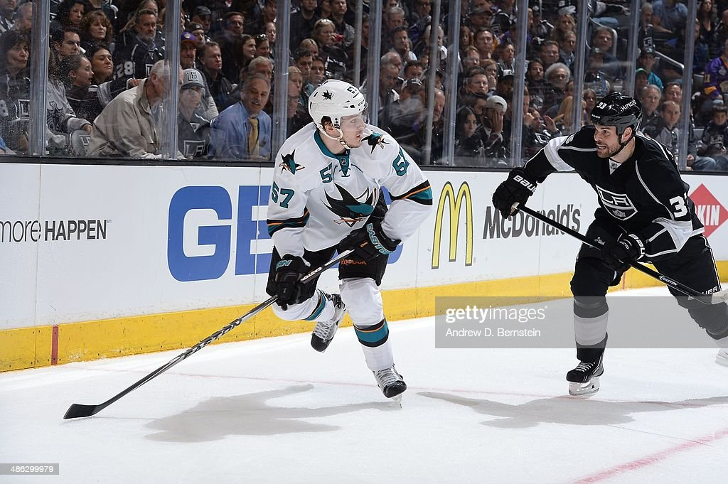 <a gi-track='captionPersonalityLinkClicked' href=/galleries/search?phrase=Tommy+Wingels&family=editorial&specificpeople=5807738 ng-click='$event.stopPropagation()'>Tommy Wingels</a> #57 of the San Jose Sharks skates with the puck against <a gi-track='captionPersonalityLinkClicked' href=/galleries/search?phrase=Willie+Mitchell+-+Ice+Hockey+Player&family=editorial&specificpeople=12876291 ng-click='$event.stopPropagation()'>Willie Mitchell</a> #33 of the Los Angeles Kings in Game Three of the First Round of the 2014 Stanley Cup Playoffs at Staples Center on April 22, 2014 in Los Angeles, California.