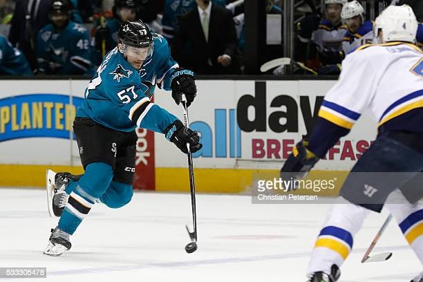 Tommy Wingels of the San Jose Sharks takes a shot against the St Louis Blues in game four of the Western Conference Finals during the 2016 NHL...
