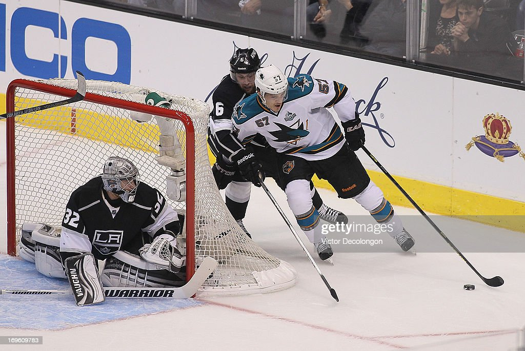 <a gi-track='captionPersonalityLinkClicked' href=/galleries/search?phrase=Tommy+Wingels&family=editorial&specificpeople=5807738 ng-click='$event.stopPropagation()'>Tommy Wingels</a> #57 of the San Jose Sharks tries to bring the puck around the net as goaltender Jonatahan Quick #32 and <a gi-track='captionPersonalityLinkClicked' href=/galleries/search?phrase=Jake+Muzzin&family=editorial&specificpeople=7205557 ng-click='$event.stopPropagation()'>Jake Muzzin</a> #6 of the Los Angeles Kings try to defend the play in the first period of Game Seven of the Western Conference Semifinals during the 2013 NHL Stanley Cup Playoffs at Staples Center on May 28, 2013 in Los Angeles, California. The Kings defeated Sharks 2-1 to advance to the Western Conference Finals.