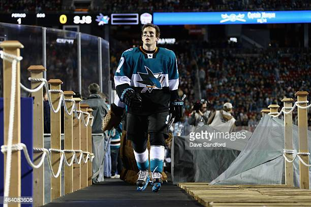 Tommy Wingels of the San Jose Sharks walks out on the field before the start of the 2015 Coors Light NHL Stadium Series game between the Los Angeles...