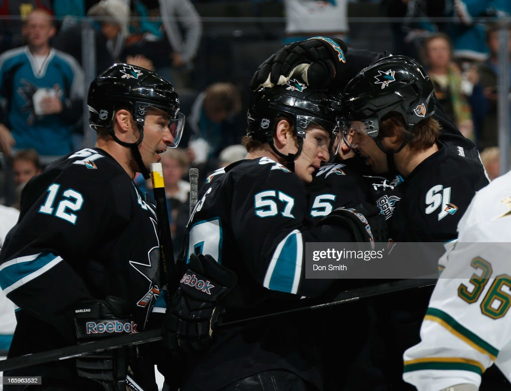 Tommy Wingels #57, Patrick Marleau #12 and Brad Stuart #7of the San Jose Sharks celebrate Wingels' goal against the Dallas Stars during an NHL game on April 7, 2013 at HP Pavilion in San Jose, California.