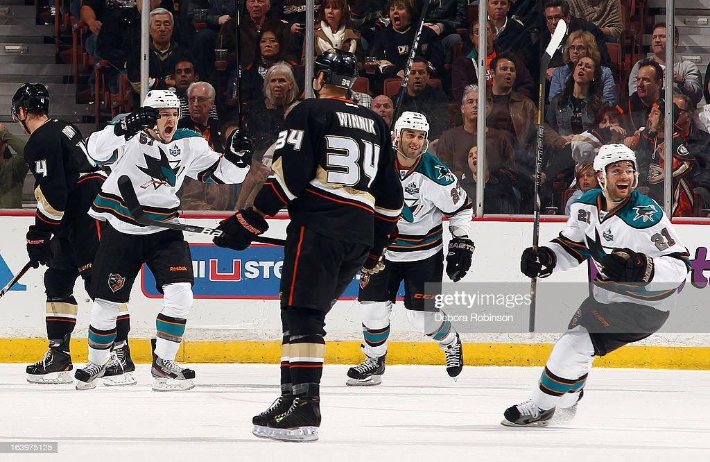 Tommy Wingels #57, Scott Gomez #23 and T.J. Galiardi #21 of the San Jose Sharks celebrate a goal scored during the game against the Anaheim Ducks on March 18, 2013 at Honda Center in Anaheim, California.