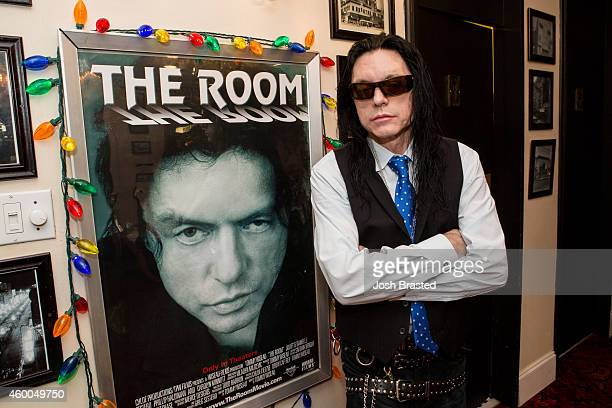 Tommy Wiseau poses next to a poster for 'The Room' at 'The Room' screening and QA at the Prytania Theatre on December 5 2014 in New Orleans Louisiana