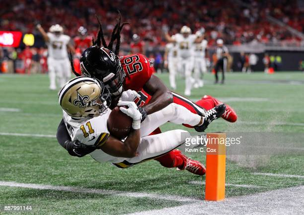 Tommylee Lewis of the New Orleans Saints dives for a touchdown as he is tackled by De'Vondre Campbell of the Atlanta Falcons at MercedesBenz Stadium...