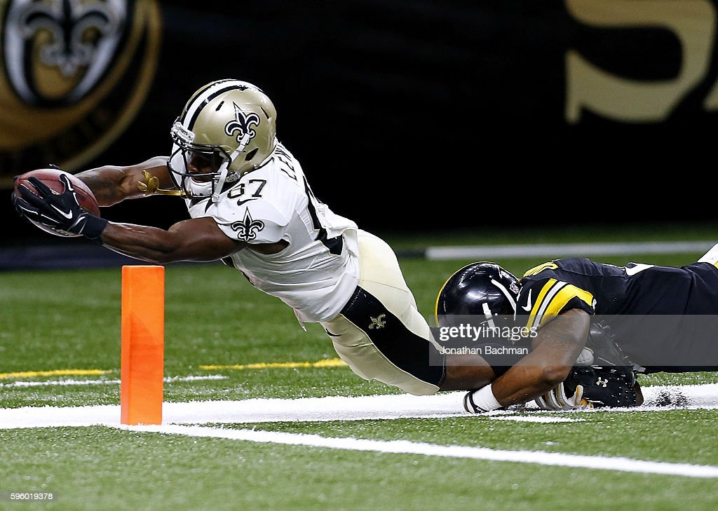 Tommylee Lewis #87 of the New Orleans Saints dives for a touchdown as Jordan Dangerfield #37 of the Pittsburgh Steelers attempts to make the tackle during the second half of a game at the Mercedes-Benz Superdome on August 26, 2016 in New Orleans, Louisiana.