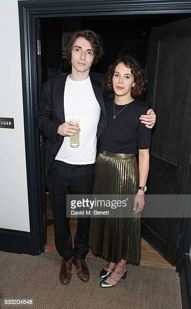 Tomo Campbell and Jessica Brown Findlay attend a private view of artist Tomo Campbell's new exhibition 'Held On The Tips Of Fingers' at Golborne...