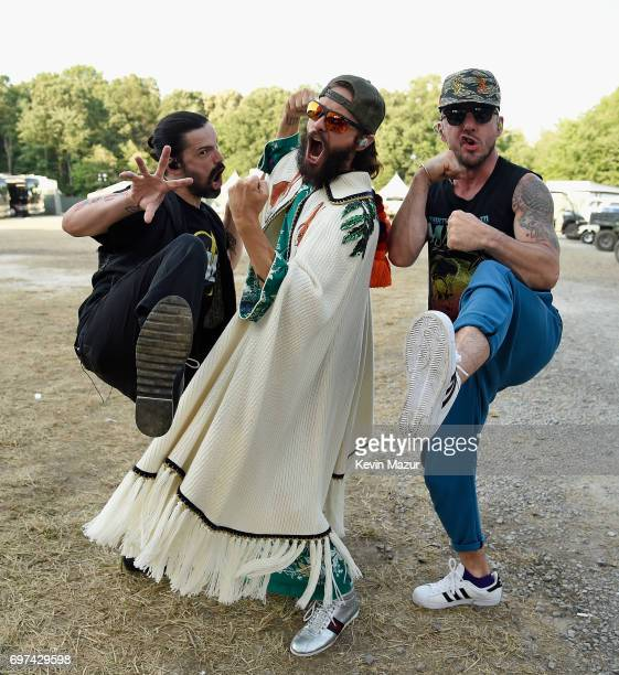 Tomo Milicevic Jared Leto and Shannon Leto of Thirty Seconds to Mars pose backstage during the 2017 Firefly Music Festival on June 18 2017 in Dover...
