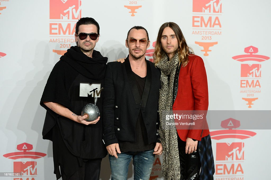 <a gi-track='captionPersonalityLinkClicked' href=/galleries/search?phrase=Tomo+Milicevic&family=editorial&specificpeople=1359203 ng-click='$event.stopPropagation()'>Tomo Milicevic</a>, <a gi-track='captionPersonalityLinkClicked' href=/galleries/search?phrase=Shannon+Leto&family=editorial&specificpeople=764946 ng-click='$event.stopPropagation()'>Shannon Leto</a> and <a gi-track='captionPersonalityLinkClicked' href=/galleries/search?phrase=Jared+Leto&family=editorial&specificpeople=214764 ng-click='$event.stopPropagation()'>Jared Leto</a> of Thirty Seconds To Mar pose in the photo room at the MTV EMA's 2013 at Ziggo Dome on November 10, 2013 in Amsterdam, Netherlands.