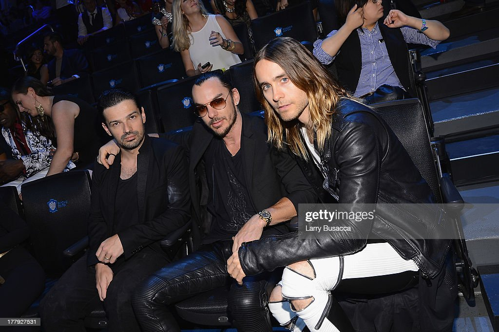 <a gi-track='captionPersonalityLinkClicked' href=/galleries/search?phrase=Tomo+Milicevic&family=editorial&specificpeople=1359203 ng-click='$event.stopPropagation()'>Tomo Milicevic</a>, <a gi-track='captionPersonalityLinkClicked' href=/galleries/search?phrase=Shannon+Leto&family=editorial&specificpeople=764946 ng-click='$event.stopPropagation()'>Shannon Leto</a> and <a gi-track='captionPersonalityLinkClicked' href=/galleries/search?phrase=Jared+Leto&family=editorial&specificpeople=214764 ng-click='$event.stopPropagation()'>Jared Leto</a> of Thirty Seconds to Mars attend the 2013 MTV Video Music Awards at the Barclays Center on August 25, 2013 in the Brooklyn borough of New York City.