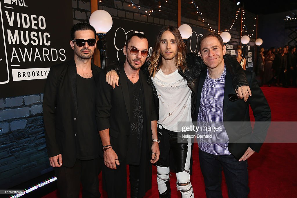 <a gi-track='captionPersonalityLinkClicked' href=/galleries/search?phrase=Tomo+Milicevic&family=editorial&specificpeople=1359203 ng-click='$event.stopPropagation()'>Tomo Milicevic</a>, <a gi-track='captionPersonalityLinkClicked' href=/galleries/search?phrase=Shannon+Leto&family=editorial&specificpeople=764946 ng-click='$event.stopPropagation()'>Shannon Leto</a> and <a gi-track='captionPersonalityLinkClicked' href=/galleries/search?phrase=Jared+Leto&family=editorial&specificpeople=214764 ng-click='$event.stopPropagation()'>Jared Leto</a> of Thirty Seconds to Mars and President of MTV Stephen Friedman attend the 2013 MTV Video Music Awards at the Barclays Center on August 25, 2013 in the Brooklyn borough of New York City.