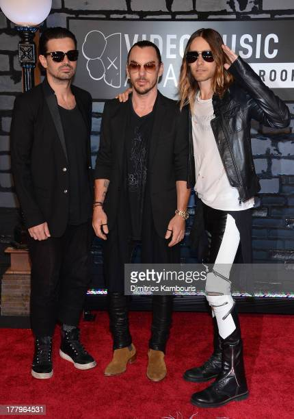 Tomo Milicevic Shannon Leto and Jared Leto of Thirty Seconds to Mars pose in the press room at the 2013 MTV Video Music Awards at the Barclays Center...