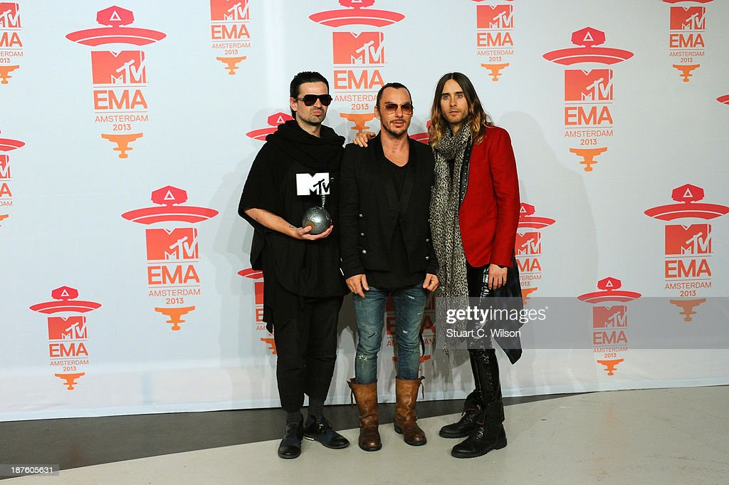 <a gi-track='captionPersonalityLinkClicked' href=/galleries/search?phrase=Tomo+Milicevic&family=editorial&specificpeople=1359203 ng-click='$event.stopPropagation()'>Tomo Milicevic</a>, <a gi-track='captionPersonalityLinkClicked' href=/galleries/search?phrase=Shannon+Leto&family=editorial&specificpeople=764946 ng-click='$event.stopPropagation()'>Shannon Leto</a> and <a gi-track='captionPersonalityLinkClicked' href=/galleries/search?phrase=Jared+Leto&family=editorial&specificpeople=214764 ng-click='$event.stopPropagation()'>Jared Leto</a> of Thirty Seconds To Mars pose with the Best Alternative award in the Exclusive Backstage Studio at the MTV EMA's 2013 at the Ziggo Dome on November 10, 2013 in Amsterdam, Netherlands.