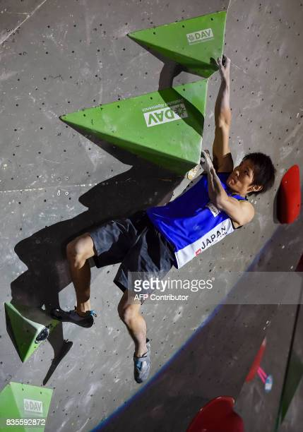 Tomoa Narasaki of Japan competes during the men's event of the IFSC Bouldering Worldcup in the southern German city of Munich on August 19 2017 / AFP...