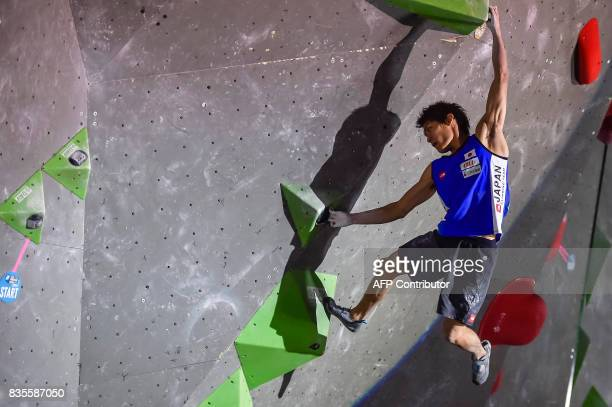 Tomoa Narasaki of Japan competes in the men's event of the IFSC Bouldering Worldcup in the southern German city of Munich on August 19 2017 / AFP...