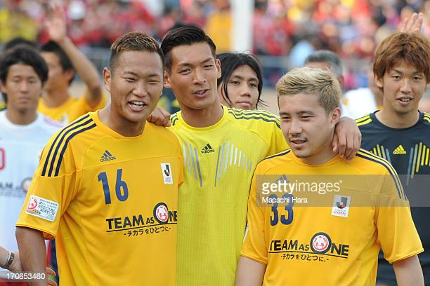 Tomoaki Makino and Michihiro Yasuda Chong Tese look on after the JLeague Special Match between JLeague Team as One and Rest of the JLeague at...