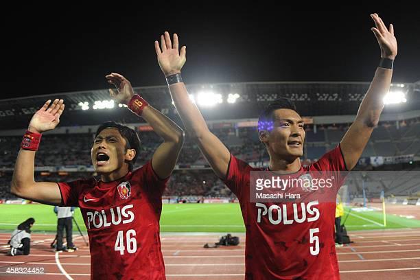 Tomoaki Makino and Ryota Moriwaki of Urawa Red Diamonds look on after the JLeague match between Yokohama FMarinos and Urawa Red Diamonds at Nissan...