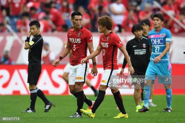 Tomoaki Makino and Toshiyuki Takagi of Urawa Red Diamonds talk at the half time during the JLeague J1 match between Urawa Red Diamonds and Sagan Tosu...
