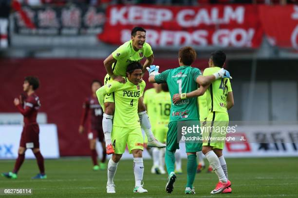Tomoaki Makino Daisuke Nasu Shusaku Nishikawa and Ryota Moriwaki of Urawa Red Diamonds celebrate their 31 victory after the JLeague J1 match between...