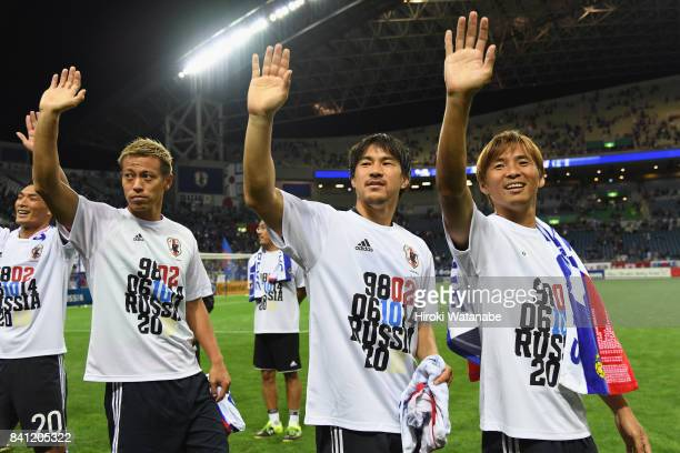 Tomoaki Makino Keisuke Honda Shinji Okazaki and Takashi Inui of Japan applaud supporters after their 20 victory and qualified for the FIFA World Cup...
