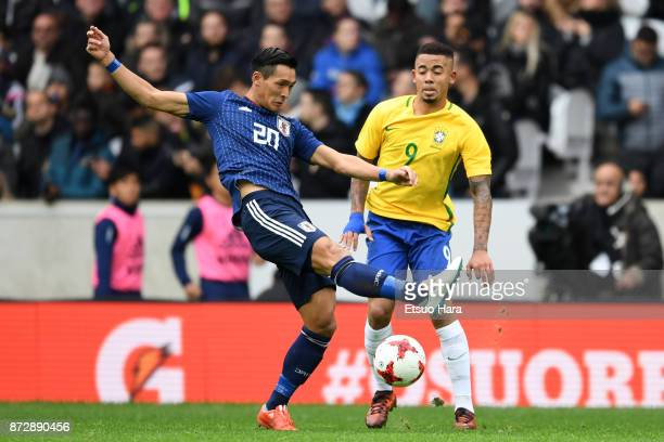 Tomoaki Makino of Japan and Gabriel Jesus of Brazil compete for the ball during the international friendly match between Brazil and Japan at Stade...
