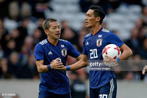 Tomoaki Makino of Japan celebrates 13 with Yosuke Ideguchi of Japan during the International Friendly match between Japan v Brazil at the Stade...