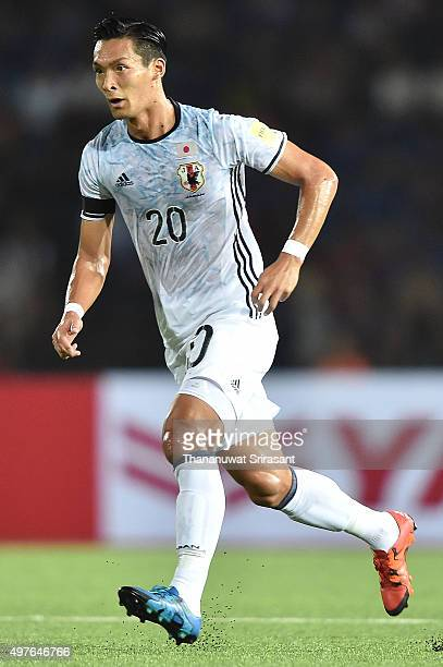 Tomoaki Makino of Japan runs during the 2018 FIFA World Cup Qualifier match between Cambodia and Japan on November 17 2015 in Phnom Penh Cambodia