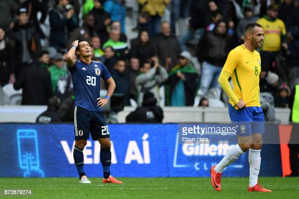 Tomoaki Makino of Japan shows dejection after his side's 13 defeat in the international friendly match between Brazil and Japan at Stade PierreMauroy...