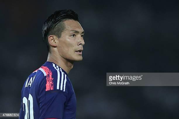 Tomoaki Makino of Japan watches on during the international friendly match between Japan and Iraq at Nissan Stadium on June 11 2015 in Yokohama Japan